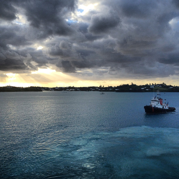 Arriving in Bermuda accompanied by storm clouds